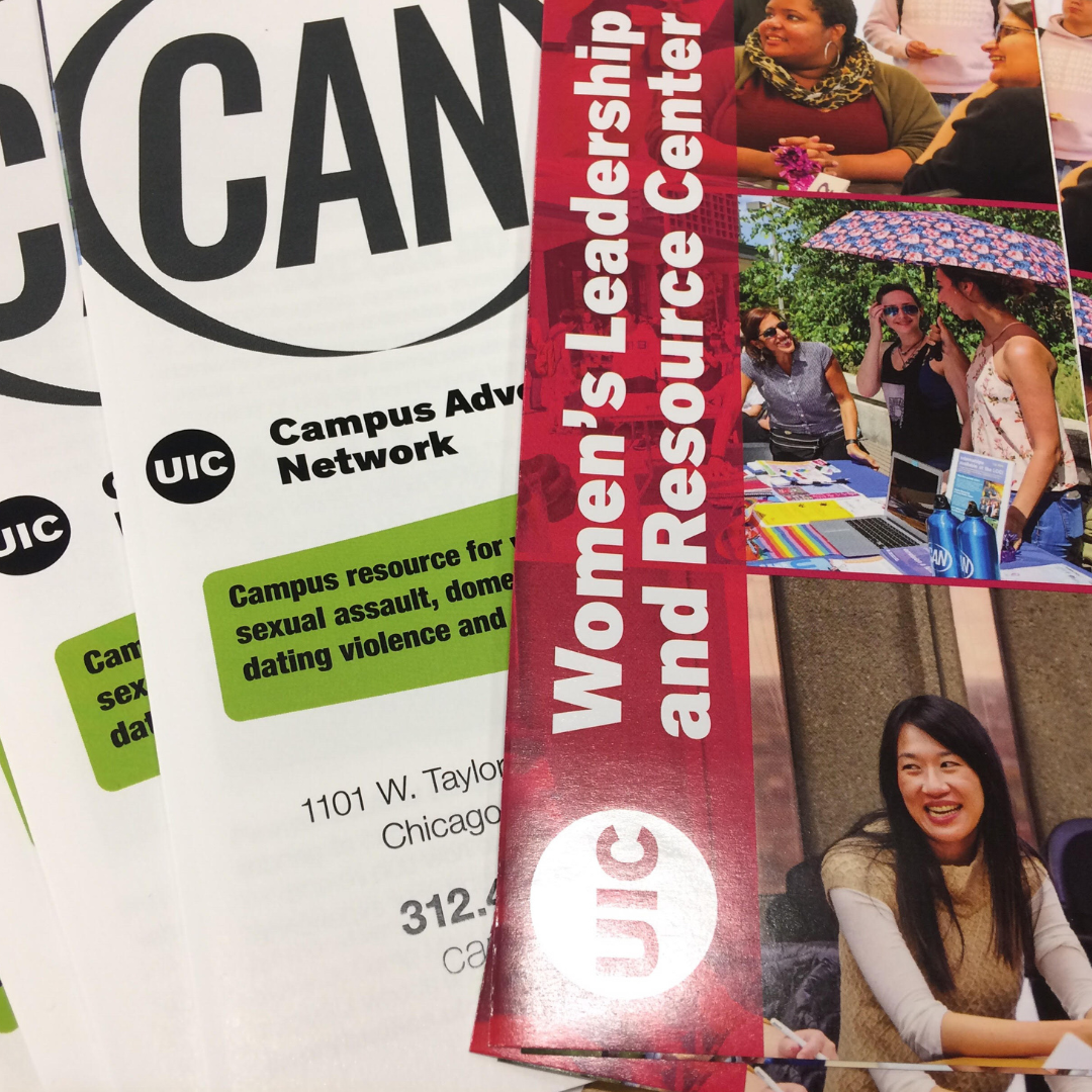 Close-up image of CAN and WLRC brochures fanned out on a table.