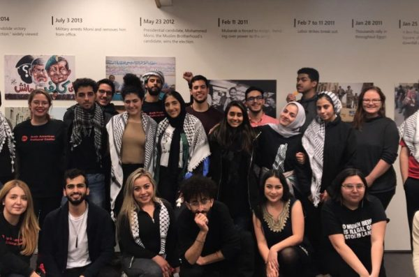 students and staff at an arab american cultural center event