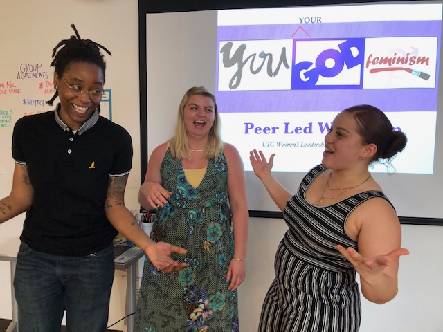 Three WLRC student employees laugh while co-presenting a workshop on Christianity and feminism
